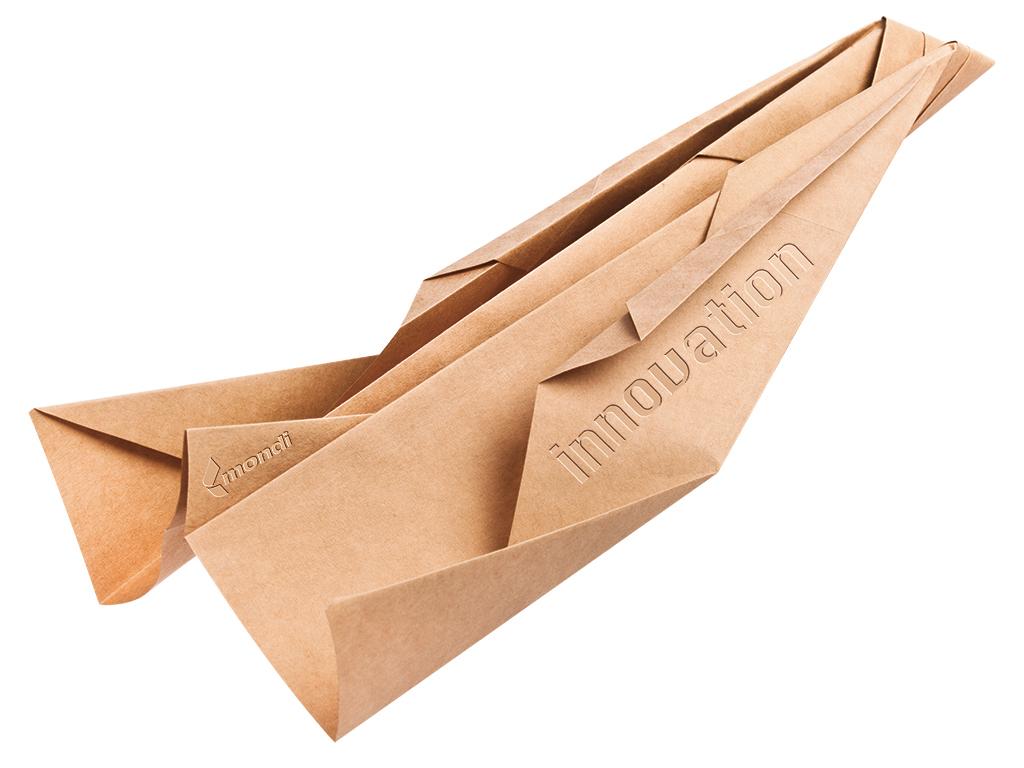Origami Papierflieger Konzept für Mondi